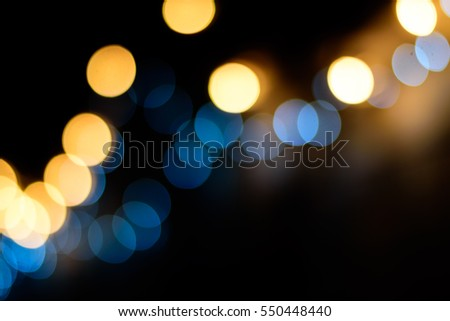 blur night lights from Udonthani Thailand,Blue and orange color bokeh maybe for background usage.