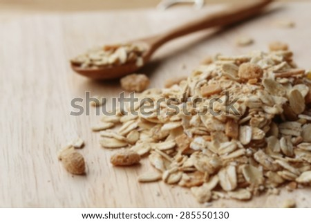 Blur Oat flakes in wooden scoop on wooden background ,Vintage style