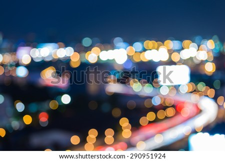 Blur of city road curve at night - stock photo