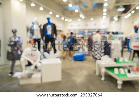Blur of city shopping people crowd at marketplace shoe shop abstract background. - stock photo