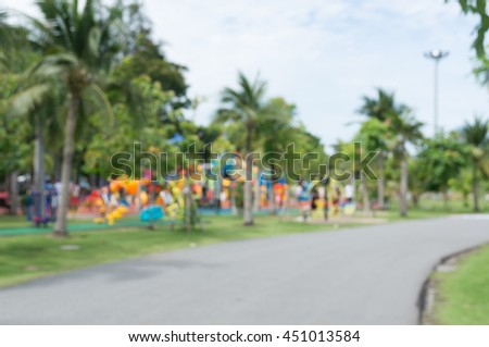 Blur of Colorful playground on yard in the park.