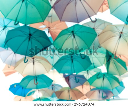 Blur of colorful umbrella street decoration. - stock photo