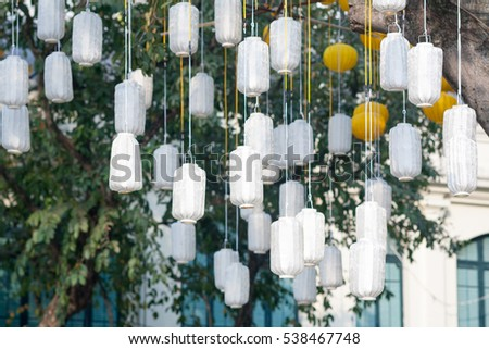 Blur of Decorative electric lamps hanging on the ceiling background