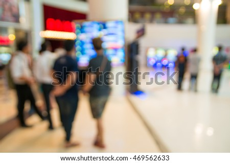 Blur of Defocus Background of People Waiting in Movie or Cinema Complex Lounge