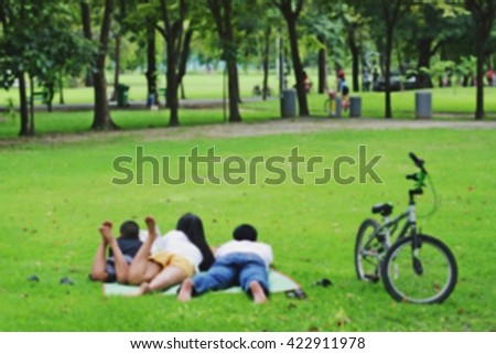 blur of Family with them bicycles in the park - stock photo