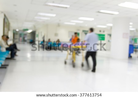 Blur of hospital hall patient go to see the doctor : Nurse pulling patient on stretcher  - stock photo
