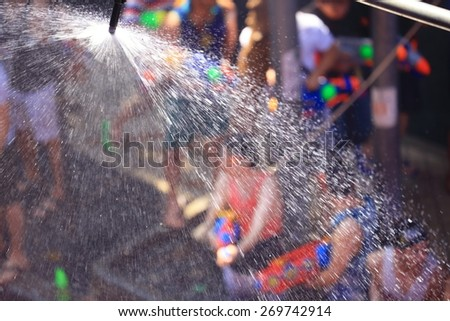 Blur of Songkran Festival at Silom Road, Bangkok in Thailand.  - stock photo