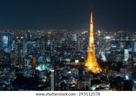 Blur of Tokyo city skyline at sunset in Tokyo, Japan. - stock photo