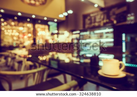 Blur or Defocus image of Coffee Shop or Cafeteria for use as Background - stock photo