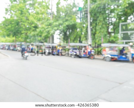 Blur outdoor on street and the Tuk Tuk parked in a row, in the Bangkok city of Thailand,. blur and abstract background - stock photo