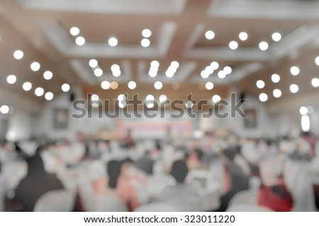 Blur people in concert hall waiting for orchestra band - stock photo