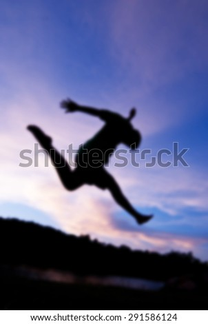 Blur people silhouette happy jumping against beautiful in sunset. Freedom, enjoyment concept. - stock photo