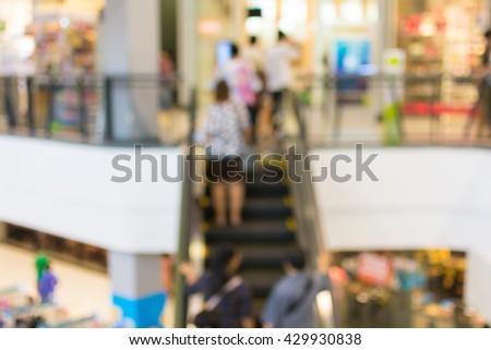blur People use escalators background. - stock photo