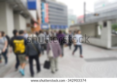 blur people walking on street in tokyo japan for background - stock photo