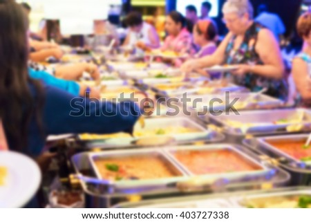 Blur picture : A Groups of Buffet in the Restaurant - stock photo