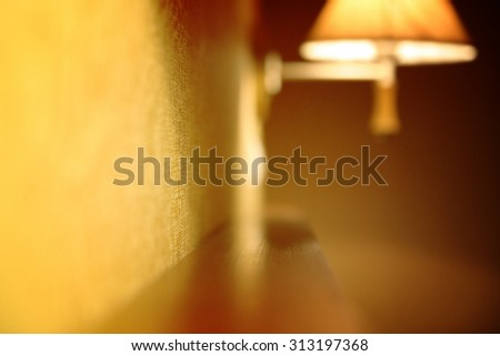 Blur picture of an orange lamp. - stock photo