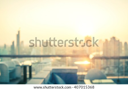 Blur restaurant at rooftop. Balcony View World City Luxury Travel Asia Booked Friend Day Skyline Sun Terrance Top Sunset Sunrise Hotel Resort Chair Table Love Business Dinner Party Sky Work concept. - stock photo