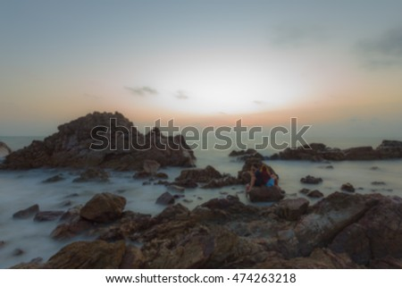 blur romantic couple on the beach in sunset