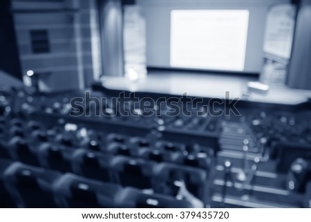 blur  row of blue classroom or auditorium  or theater and stage with screen - stock photo