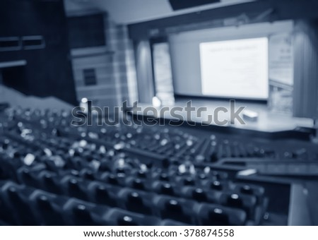 blur  row of blue classroom or auditorium  or theater seat and stage - stock photo