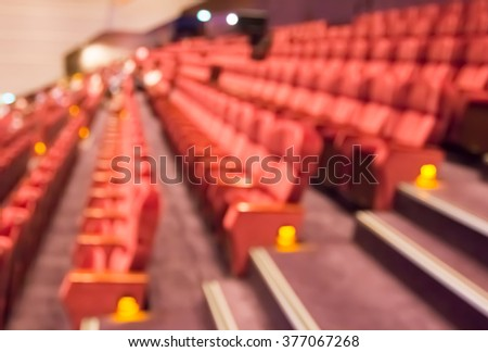 blur row of red auditorium  or theater or classroom seat and stair - stock photo
