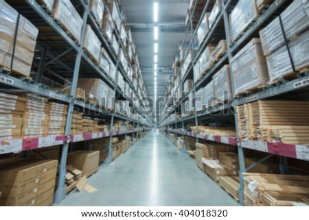 Blur  Rows of shelves with boxes in warehouse