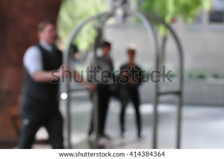 Blur scene bellman with luggage cart. - stock photo