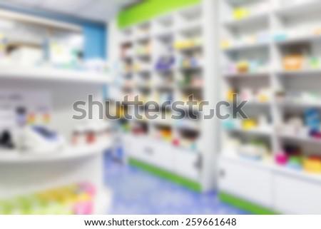blur shelves of drugs in the pharmacy - stock photo