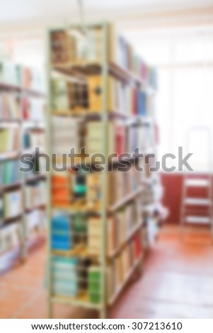 blur shelves with books in the library, vertical background - stock photo