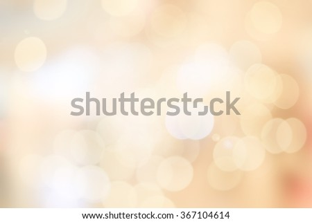Blur shining brighten soft cream yellow wallpaper with circle lantern:abstract blurred background in light tone.blurry bulbs ball motion aura golden cream color backdrop.blurry sparkle glitter concept - stock photo
