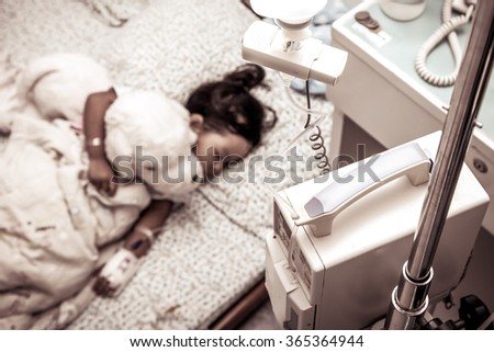 Blur sick little girl sleeping in the hospital in vintage color filter - stock photo