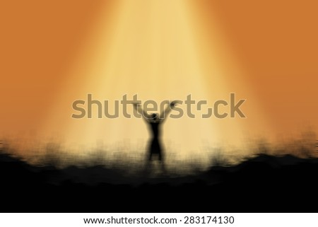 Blur Silhouette of man standing on the mountain raise exposure. - stock photo