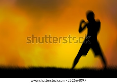 blur silhouette Thai boxing  Orange background