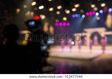 blur singer in studio of television station with camera and cameraman - stock photo