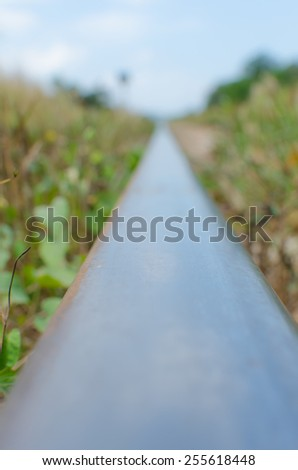 Blur single railway track background in a rural scene - stock photo