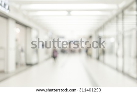Blur store with bokeh background. Silhouettes of Business People in Blurred Motion Walking. Business people walking in the office corridor. - stock photo