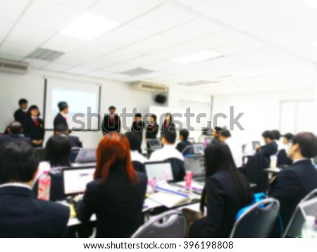 Blur student during study, lecture, quiz, exams, present project to teacher or professor in classroom with notebook in master degree of industrial management programs or MBA class. study concept.  - stock photo