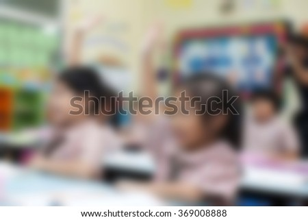 blur students in the classroom for background usage - stock photo
