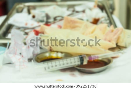 blur syringe with needle use for xylocaine injection in laceration wound - stock photo