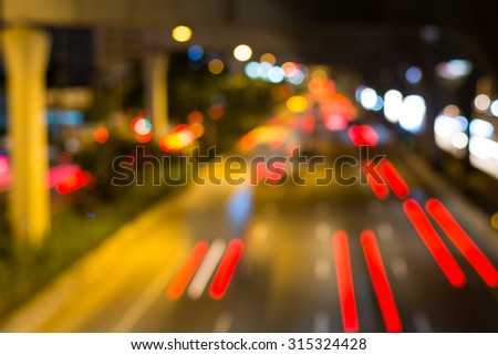 Blur traffic and car lights bokeh in rush hour background. Photo Of Bokeh Lights / Street Lights Out Of Focus - stock photo