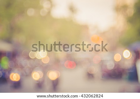 Blur traffic road and colorful bokeh light with sun light abstract background.Retro color style. - stock photo