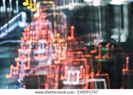 Blur traffic road with bokeh light abstract background.