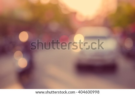 Blur traffic road with bokeh light abstract background. Retro color style. - stock photo