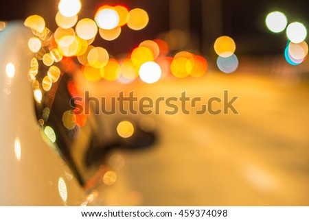 Blur traffic road with bokeh light abstract background.Retro color style. - stock photo
