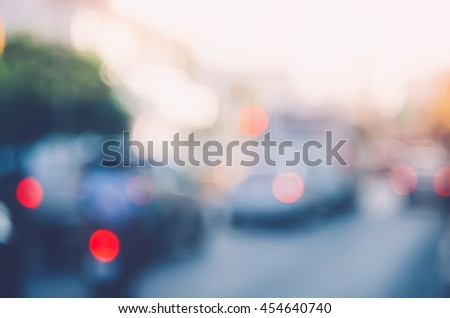 Blur traffic road with colorful bokeh light abstract background. Copy space of transportation and travel concept. Retro tone filter color style. - stock photo