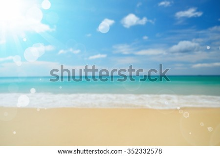 Blur tropical beach with sun light abstract background.Travel concept.