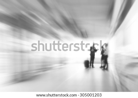 Blur white gray business abstract background with people standing in the corridor, zoom effect