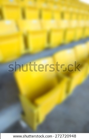 blur yellow stadium seats - stock photo