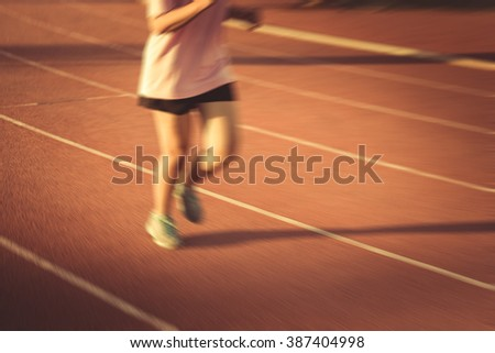 blur young fitness woman running , sunset ,  vintage tone