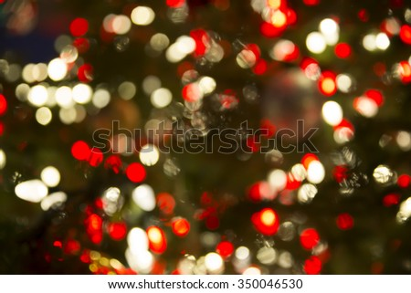 Blured background of christmas ornaments on Christmas tree. Bokeh